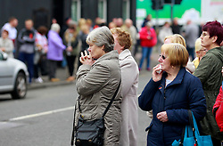 © Licensed to London News Pictures. 22/03/2016. Belfast, Northern Ireland, UK. People attending the funeral of murdered prison officer Adrian Ismay at Woodvale Methodist church. Mr Ismay died following a booby-trap bomb that exploded under his van in East Belfast on March 4th. Photo credit: Peter Morrison/LNP
