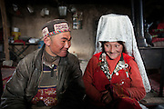 Tella Bu (the late Khan's youngest daughter) and her husband Daryo Boi, the shepherd of the camp. The Khan is the tribal leader of the Afghan Kyrgyz community..Inside Ikhbal's house - Ikhbal is the last wife of the late Khan. His two previous wives died in labor. The Afghan Kyrgyz community have the highest maternal mortality rate in the world, estimated at 30%.....Trekking through the high altitude plateau of the Little Pamir mountains, where the Afghan Kyrgyz community live all year, on the borders of China, Tajikistan and Pakistan.
