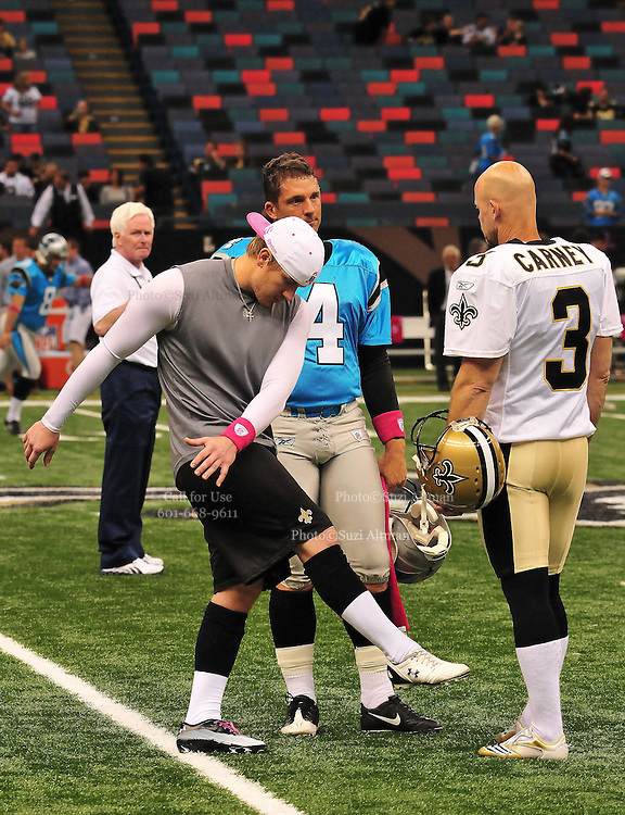 """New Orleans Saints kicker John Carney, recently resigned, is seen giving instructions to New Orleans kicker Garrett Hartley while the Carolina Panthers kicker John Kasey watches nad gives advice prior to the Saints -v-Panthers game Sunday Oct. 3,2010. Carney went on to kick three feild goals to help the saints win while Hartley did not play at all. The NFL has gone """"Pink"""" for October in honor of Breast Cancer Awareness. The Saints went on to win 16-14. John Carney kicked three field goals to help the Saints win. PHOTO©SuziAltman.com"""