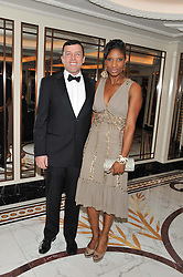 DENISE LEWIS and her husband STEVE FINAN at the 22nd Cartier Racing Awards held at The Dorchester, Park Lane, London on 13th November 2012.