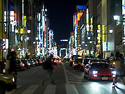 a major crossroad through the city at night Ginza Tokyo