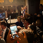 Hillary Clinton, former Secretary of State and 2016 Democratic presidential candidate, poses for photos with attendees during a campaign event in New York, U.S., on Monday, April 18, 2016. Polls show Clinton and Republican Donald Trump with double-digit leads heading into the New York primary on Tuesday, and both candidates are hoping that strong victories on their home-court will reset their respective races and catapult them toward the finish line. Photographer: John Taggart/Bloomberg *** Local Caption *** Hillary Clinton