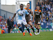 Blackburn Rovers Amari'i Bell shields the ball from Sergi Canós of Brentford during the EFL Sky Bet Championship match between Blackburn Rovers and Brentford at Ewood Park, Blackburn, England on 25 August 2018.