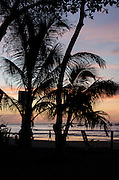 Person walking on the beach at sunset, Tamarindo, Guanacaste, Costa Rica