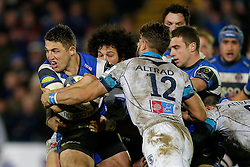 Bath Inside Centre Sam Burgess, making his first start for the Club, is tackled by Montpellier Inside Centre Wynand Olivier  and replacement Rene Ranger - Photo mandatory by-line: Rogan Thomson/JMP - 07966 386802 - 12/12/2014 - SPORT - RUGBY UNION - Bath, England - The Recreation Ground - Bath Rugby v Montpellier Herault Rugby - European Rugby Champions Cup Pool 4.