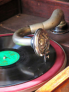 Close up of a Gramaphone arm, needle and a 78 RPM record