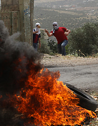 May 24, 2019, Nablus, West Bank: A Palestinian protester hurls stones at Israeli soldiers during clashes after a protest against the expanding of Jewish settlements in Kufr Qadoom village near the West Bank city of Nablus. (Credit Image: © Zhao Yue/Xinhua via ZUMA Wire)