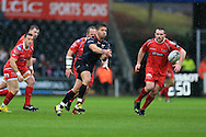 Rhys Webb of the Ospreys © passes the ball. Guinness Pro12 rugby match, Ospreys v Scarlets at the Liberty Stadium in Swansea, South Wales on Saturday 26th March 2016.<br /> pic by  Andrew Orchard, Andrew Orchard sports photography.