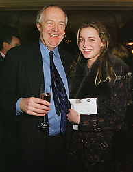 SIR TIM RICE and his daughter MISS EVA RICE, at a party in London on 2nd March 1999.MOX 41