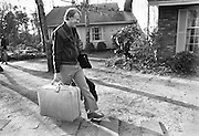 Candidate Jimmy Carter returns home to his  Plains, Georgia home the morning after winning the Iowa primary - a win that propelled Carter to the White House. A modest man, Carter carried his bags himself . - To license this image, click on the shopping cart below -