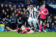 West Brom's Stephane Sesegnon evades a Peterborough challenge. The Emirates FA Cup, 4th round match, West Bromwich Albion v Peterborough Utd at the Hawthorns stadium in West Bromwich, Midlands on Saturday 30th January 2016. pic by Carl Robertson, Andrew Orchard sports photography.