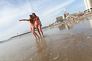 Two young girls enjoying a summer day on the beach Photographed in Tel Aviv, Israel