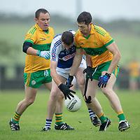 St. Senan's Kilkee's Barry Harte is tackled by O'Curry's Damian Carmody and Michael O'Shea