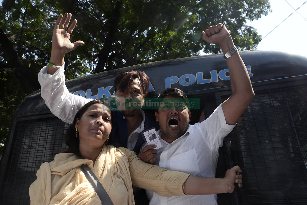 April 24, 2018 - Kolkata, West Bengal, India - Police detain Congress activist during the agitation in front of State Election Commission. Congress activist participate in a demonstration to protest against violence in front of State Election commission. (Credit Image: © Saikat Paul/Pacific Press via ZUMA Wire)