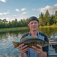 Ben Wiltsie displays a large bass he caught in Lake of the Woods, near Kenora, Ontario, Canada.