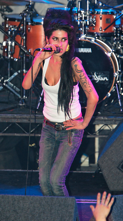 Singer Amy Winehouse, DOB=14/09/1983, performing for her gay fans at the G-A-Y Club. G-A-Y is London's biggest gay club and is held at the London Astoria nightclub, Soho, London, UK. Amy spent much of the show rubbing her itchy nose. She also seemed to have signs of old scars all down one arm...Picture Data:.Photographer: Edward Hirst.Copyright: ©2007 Licensed to Equinox News Pictures +448700 780000.Contact: Equinox Features.Date Taken: 20070415.Time Taken: 014953+0000.www.newspics.com
