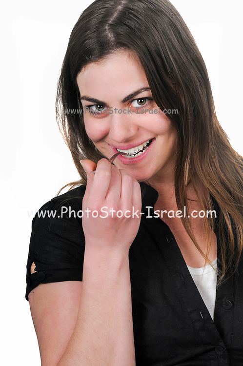 Young woman enjoys a spoon of food