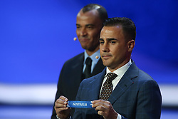 December 1, 2017 - Moscow, Russia - Draw assistant, Fabio Cannavaro (R) draws Australia during the Final Draw for the 2018 FIFA World Cup Russia at the State Kremlin Palace on December 1, 2017 in Moscow, Russia. (Credit Image: © Igor Russak/NurPhoto via ZUMA Press)