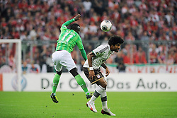 25.09.2013, Allianz Arena, Muenchen, GER, DFB Pokal, FC Bayern Muenchen vs Hannover 96, 2. Runde, im Bild Links Didier Ya Konan (Hannover96) im Zweikampf, Aktion, mit Dante (FC Bayern Muenchen),rechts, quer,querformat,horizontal,landscape // during German DFB Pokal Match between FC Bayern Munich and Hannover 96 at the Allianz Arena, Munich, Germany on 2013/09/25. EXPA Pictures © 2013, PhotoCredit: EXPA/ Eibner/ Wolfgang Stuetzle<br /> <br /> ***** ATTENTION - OUT OF GER *****