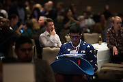 Phavik Patel of Cedar Hill watches the election coverage during the Dallas County Democratic watch party in Dallas, Texas on November 8, 2016. (Cooper Neill for The Texas Tribune)