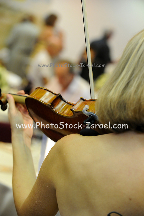 Female violinist as seen from her back