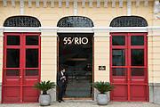 The doorman waits at the Hotel 55 Rio in an restored Portuguese colonial building along the Avenida República do Paraguai in the Lapa neighborhood of Rio de Janeiro, Brazil.