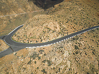 Aerial view of a turn of the famous winding mountain road that links the small towns of Casillas del Ángel and Pájara in Fuerteventura, Canary Islands.