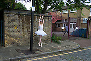 Ballet dancer from the Ruggieri Dance Academy practices her positions in an unexpected urban environment prior to a performance at a local Summer event in Wapping, London, England, United Kingdom. (photo by Mike Kemp/In Pictures via Getty Images)