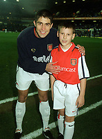 Silvinho with the Arsenal mascot before the match. Tottenham 1:1 Arsenal, FA Carling Premiership, 18/12/2000. Credit Colorsport / Stuart MacFarlane.