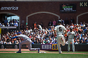 San Francisco Giants catcher Nick Hundley (5) can't beat the throw at first base to Los Angeles Dodgers first baseman Scott Van Slyke (33) at AT&T Park in San Francisco, California, on April 27, 2017. (Stan Olszewski/Special to S.F. Examiner)