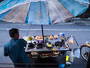 24 MARCH 2015 - BANGKOK, THAILAND:    A food vendor in Wong Wian Yai station in the Thonburi section of Bangkok. PHOTO BY JACK KURTZ
