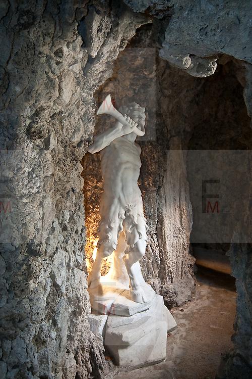 La Statua di un fauno nel Ninfeo della villa Litta Borromeo a Lainate..The statue of a faun inside the Ninfeo of Villa Litta Borromeo in Lainate