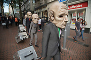 KTO Theatre Peregrinus appear suddenly in striking masks in this wandering theatre<br /> show, inspired by TS Eliot's The Hollow<br /> Men for the Birmingham Weekender Arts And Culture Festival on 23rd September 2017 in Birmingham, United Kingdom.