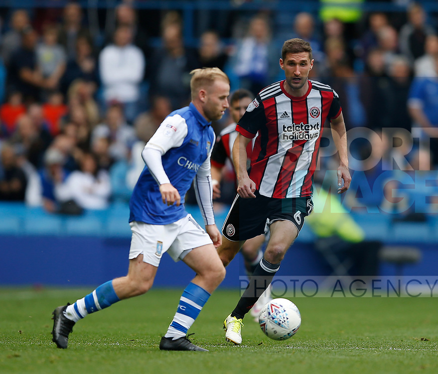 Barry Bannan of Sheffield Wednesday tackled by Chris Basham of Sheffield Utd during the Championship match at the Hillsborough Stadium, Sheffield. Picture date 24th September 2017. Picture credit should read: Simon Bellis/Sportimage