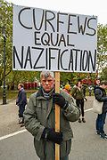"""Protesters gather and hold placards during a """"Match the Million"""" march for free speech, free assembly, and freedom from lockdowns in Hyde Park, Central London, on Saturday, Oct 10, 2020. (VXP Photo/ Vudi Xhymshiti)"""