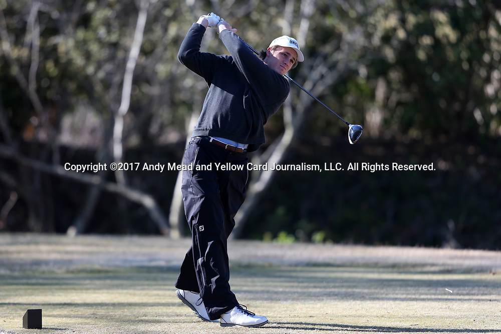 WILMINGTON, NC - MARCH 19: UNC Wilmington's Reese McFarlane tees off on the Ocean Course fifth hole. The first round of the 2017 Seahawk Intercollegiate Men's Golf Tournament was held on March 19, 2017, at the Country Club of Landover Nicklaus Course in Wilmington, NC.