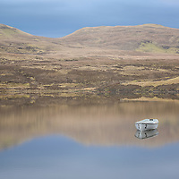 A brief moment of stillness at a small loch near Storr, on the Isle of Skye, Scotland.