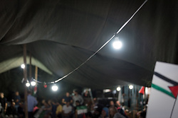 3 October 2018, Jerusalem, Occupied Palestinian Territories: It is late evening in Khan al Ahmar. Located on a small hill in the E1 area of the East Jerusalem periphery, Khan al Ahmar is made up largely from families of Palestinian refugees from 1948. Khan al Ahmar is a Bedouin community located within the East Jerusalem Periphery, in E1 area. It is home to 32 families, 173 persons in total, including 92 children and youths. The community has a mosque and a school, which was built in 2009 and serves more than 150 children between the ages of six and fifteen, from Khan al Ahmar and other nearby communities. With due date 1 October 2018, Israeli authorities threaten to demolish the site, thereby making room for nearby Israeli settlements to expand.