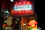 Jazz funeral on offer in sign in famous Bourbon Street in French Quarter of New Orleans, USA
