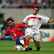 Costa Rica's Wilmer Lopez tackled by Turkey's Fatih Akyel