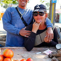 Central America, Cuba, Santa Clara. A Cuban couple sells fresh vegetables in Santa Clara.