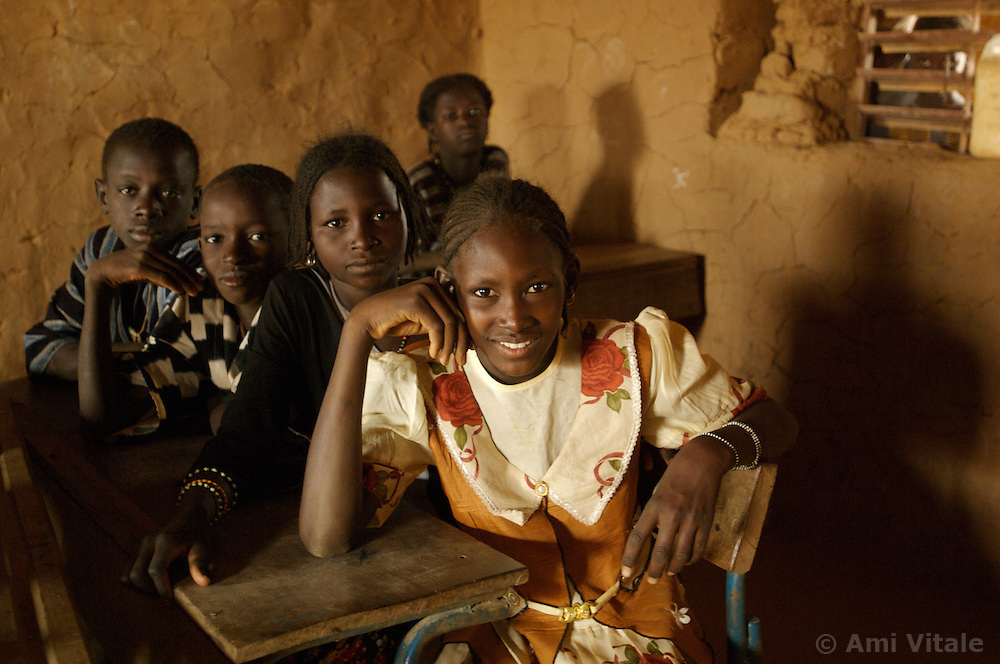 Muna, wearing white flowered dress, sits in a classroom in the  village of Intedeyne March 15, 2007.    the challenge to educate children in Mali still exists and particularly for girls. Female literacy rates never reach even 50 percent of male literacy rates. Mali has the highest percentage of people living below the poverty line in any country in the world. Ninety percent of Malians survive on less than two dollars a day.
