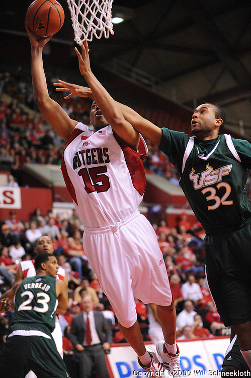 Mar 7, 2009; Piscataway, NJ, USA; Rutgers forward J.R. Inman (15) is fouled by South Florida forward Aris Williams (32) during the second half of Rutgers' senior day game against South Florida at the Louis Brown Athletic Center.  Rutgers won 45-42.