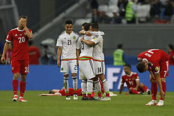 June 24, 2017 - Kazan, Russia - Russia national team players Maksim Kanunnikov (L), Alexander Samedov (2nd R) and Dmitry Poloz (R) react as Mexico national team players Luis Reyes (N21), Javier Hernandez (N14) and Jonathan Dos Santos celebrate victory during the Group A - FIFA Confederations Cup Russia 2017 match between Russia and Mexico at Kazan Arena on June 24, 2017 in Kazan, Russia. (Credit Image: © Mike Kireev/NurPhoto via ZUMA Press)