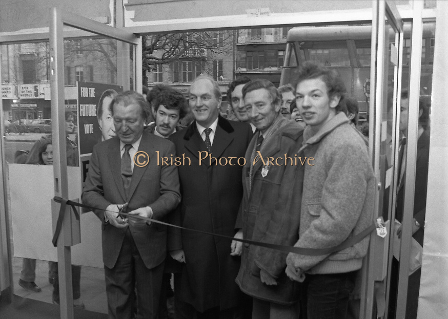 """Opening of New Ogra Fianna Fail office on O'Connell St,Dublin.1982.30.01.1982.01.30.1982.30th January 1982..Photograph of Mr Charles Haughey,.Leader of Fianna Fail cutting the ribbon to officially open th new """"Ogra"""" office. He is accompanied by Mr George Colley T.D.,Mr Bertie Ahearn T.D.,Mr Tom Leonard (candidate) and Mr Paul Edgehill a member of Ogra Fianna Fail..."""