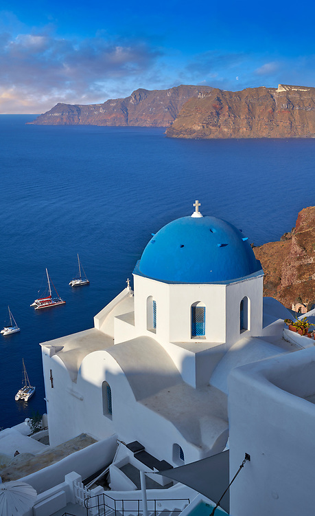 Traditional blue domed Greek Orthodox church of Oia, Island of Thira, Santorini, Greece. .<br /> <br /> If you prefer to buy from our ALAMY PHOTO LIBRARY  Collection visit : https://www.alamy.com/portfolio/paul-williams-funkystock/santorini-greece.html<br /> <br /> Visit our PHOTO COLLECTIONS OF GREECE for more photos to download or buy as wall art prints https://funkystock.photoshelter.com/gallery-collection/Pictures-Images-of-Greece-Photos-of-Greek-Historic-Landmark-Sites/C0000w6e8OkknEb8