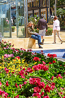 Avenida del Mar, Marbella, Spain, girl using mobile phone, April, 2018. 201804144293<br /> <br /> Copyright Image from Victor Patterson, 54 Dorchester Park, Belfast, UK, BT9 6RJ<br /> <br /> t1: +44 28 9066 1296 (from Rep of Ireland 048 9066 1296)<br /> t2: +44 28 9002 2446 (from Rep of Ireland 048 9002 2446)<br /> m: +44 7802 353836<br /> <br /> e1: victorpatterson@me.com<br /> e2: victorpatterson@gmail.com<br /> <br /> The use of any of my copyright images is subject to my Terms & Conditions. It is IMPORTANT that you familiarise yourself with them. They are available at my website, victorpatterson.com.<br /> <br /> None of my copyright images may be used on the Internet unless they are visibly watermarked, i.e. © Victor Patterson within the body of the image. My metadata, denoting my copyright must NOT be deleted. <br /> <br /> Web use is extra at currently recommended NUJ rates. Maximum permitted web size is<br />  400kb. <br /> <br /> Images must not be passed on to a third party - they are for the use of the authorised recipient only.