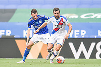 LEICESTER, ENGLAND - JULY 04:  of Crystal Palace shields the ball from Jamie Vardy of Leicester City during the Premier League match between Leicester City and Crystal Palace at The King Power Stadium on July 4, 2020 in Leicester, United Kingdom. Football Stadiums around Europe remain empty due to the Coronavirus Pandemic as Government social distancing laws prohibit fans inside venues resulting in all fixtures being played behind closed doors. (Photo by MB Media)