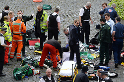 Conservative MP Tobias Ellwood (centre) stands amongst the emergency services at the scene outside the Palace of Westminster, London, after policeman has been stabbed and his apparent attacker shot by officers in a major security incident at the Houses of Parliament.