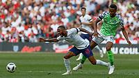 Football - 2018 International Friendly (pre-World Cup warm-up) - England vs. Nigeria<br /> <br /> Raheem Sterling (England) is fouled by John Obi Mikel (Nigeria) at Wembley Stadium.<br /> <br /> COLORSPORT/DANIEL BEARHAM